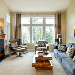 This is an example of a contemporary living room in Portland with beige walls.