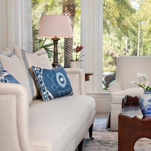 Esempio di un grande soggiorno tropicale chiuso con sala formale, pareti bianche, pavimento in gres porcellanato, camino classico, cornice del camino in pietra e nessuna TV