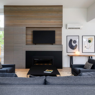 Mid-sized trendy light wood floor, white floor and shiplap wall living room photo in Seattle with white walls, a standard fireplace and a tv stand
