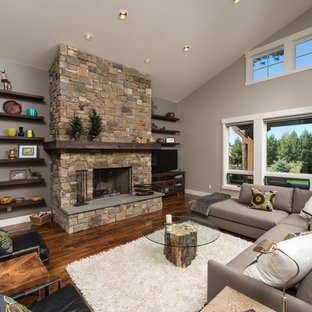 Inspiration for a large contemporary open concept living room remodel in Other with gray walls, a standard fireplace and a stone fireplace