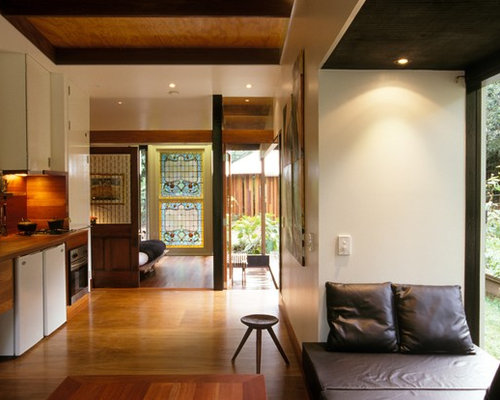tropical living room design ideas, remodels & photos with plywood