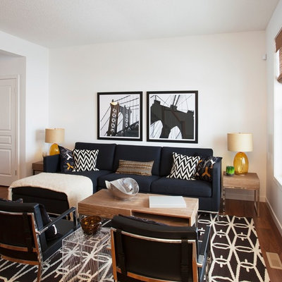 Inspiration for a contemporary open concept living room remodel in Calgary with white walls