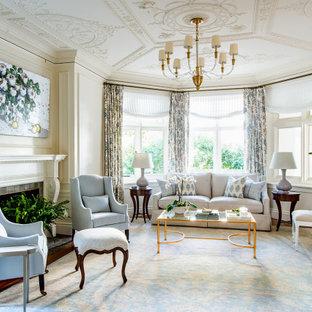 Immagine di un soggiorno chic con pareti bianche, moquette, camino classico, pavimento blu e boiserie