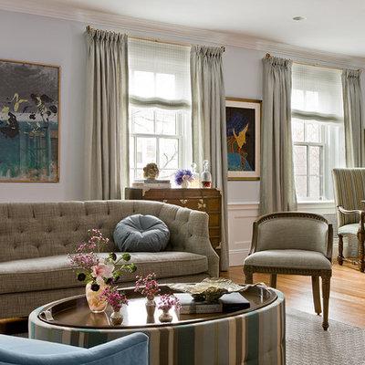 Trendy medium tone wood floor living room photo in Boston with blue walls