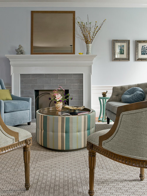 Example Of A Trendy Living Room Design In Boston With Tile Fireplace