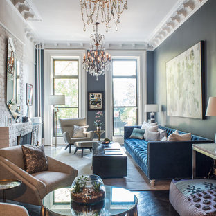 Mid-sized eclectic open concept dark wood floor and black floor living room photo in New York with gray walls, a standard fireplace, a brick fireplace and no tv