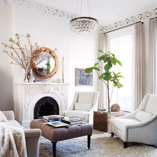 Example of a mid-sized ornate formal and enclosed carpeted living room design in New York with white walls, a standard fireplace, a metal fireplace and no tv