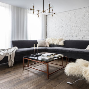 inspiration for a mid sized scandinavian open concept dark wood floor and brown floor living - Scandinavian Living Room