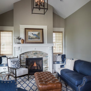 Design ideas for a traditional formal living room in Indianapolis with grey walls, a standard fireplace and a stone fireplace surround.
