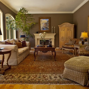 Example of a classic enclosed living room design in San Francisco with brown walls and a standard fireplace