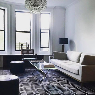 Living room - mid-sized contemporary formal and open concept dark wood floor and black floor living room idea in New York with white walls, a standard fireplace, a brick fireplace and no tv