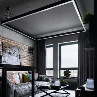 На фото: открытая гостиная комната среднего размера в стиле лофт с серыми стенами с