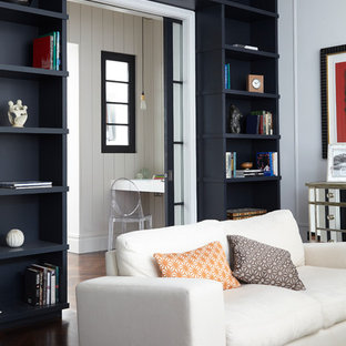 Example of a transitional dark wood floor living room design in London with gray walls