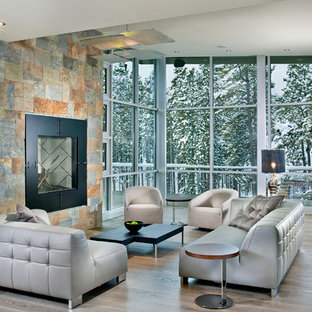 Example of a huge trendy formal and open concept light wood floor and gray floor living room design in Atlanta with a stone fireplace, gray walls, a standard fireplace and no tv