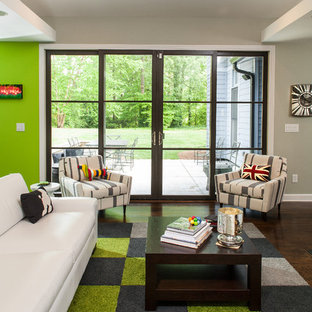 Inspiration for a contemporary living room remodel in Atlanta with green walls
