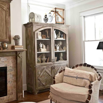 Built-in Antiqued Cabinetry and French Settee with Linen Slipcover
