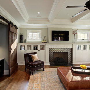Example of an arts and crafts open concept dark wood floor living room design in Chicago with a standard fireplace, a brick fireplace and a wall-mounted tv