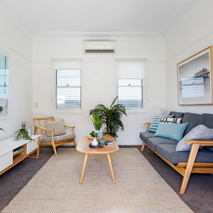 Mid-sized scandinavian formal enclosed living room in Sydney with white walls, carpet and brown floor.