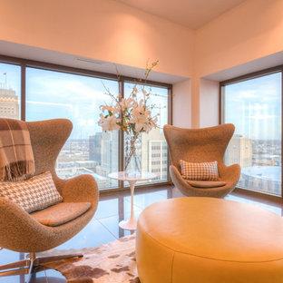 Ispirazione per un ampio soggiorno minimalista aperto con pareti bianche, pavimento con piastrelle in ceramica, camino bifacciale, cornice del camino piastrellata e TV a parete