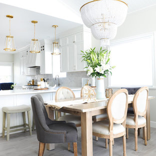 Inspiration for a transitional open concept laminate floor and gray floor living room remodel in Vancouver with white walls