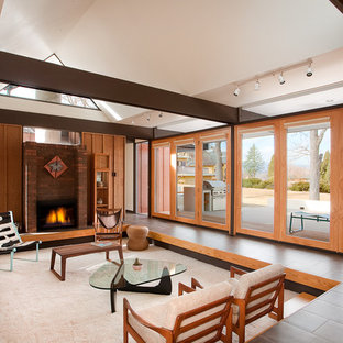 Example of a minimalist open concept living room design in Denver with no tv