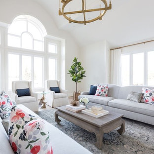 Inspiration for a large transitional formal and enclosed light wood floor and brown floor living room remodel in Toronto with white walls, a standard fireplace, a stone fireplace and no tv