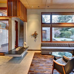 サンフランシスコのモダンスタイルのおしゃれなLDK (コンクリートの床、横長型暖炉、金属の暖炉まわり、テレビなし) の写真