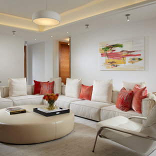 Mid-sized trendy enclosed marble floor and white floor living room photo in Miami with white walls and a media wall
