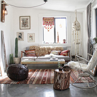 Design ideas for a bohemian formal enclosed living room in Los Angeles with white walls and concrete flooring.