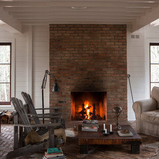Design ideas for a country living room in Montreal with white walls and brick floors.