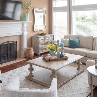Inspiration for a mid-sized transitional formal and enclosed vinyl floor and brown floor living room remodel in Chicago with brown walls, a standard fireplace, a tile fireplace and a wall-mounted tv