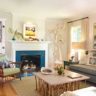 Living room - beach style enclosed living room idea in Los Angeles with beige walls, a standard fireplace and a tile fireplace