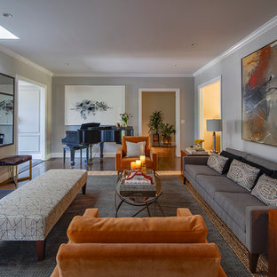 Design ideas for a large midcentury open concept living room in San Francisco with a music area, grey walls, medium hardwood floors, a standard fireplace and a wood fireplace surround.