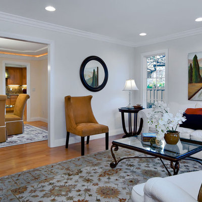 Living room - contemporary medium tone wood floor living room idea in San Francisco with white walls