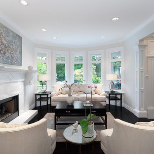 Elegant formal and open concept living room photo in Vancouver with a ribbon fireplace