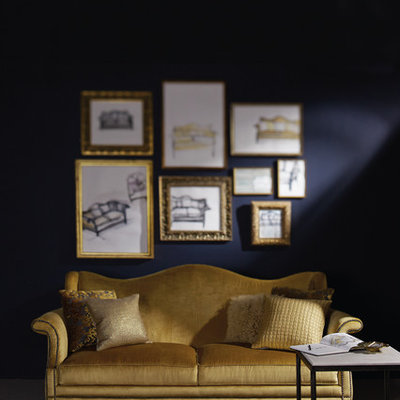 Example of a trendy living room design in New York with blue walls