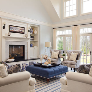 Inspiration for a large beach style enclosed dark wood floor living room remodel in Portland with blue walls, a standard fireplace and a stone fireplace