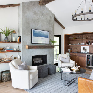 Living room - mid-sized transitional medium tone wood floor and brown floor living room idea in Austin with white walls, a standard fireplace, a concrete fireplace and a wall-mounted tv
