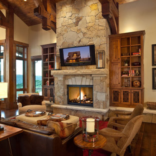Example of a large mountain style living room design in Salt Lake City with beige walls, a standard fireplace and a stone fireplace