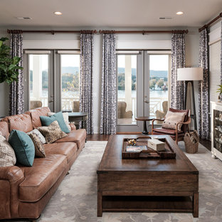 Example of a mid-sized transitional open concept medium tone wood floor and brown floor living room design in Other with gray walls and a wall-mounted tv