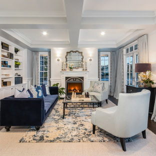 Design ideas for a traditional living room in Brisbane with white walls, dark hardwood floors, a standard fireplace, brown floor, coffered and decorative wall panelling.