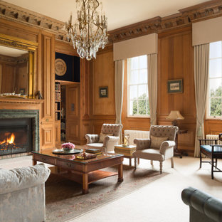 Classic enclosed living room in Other with brown walls, carpet, a standard fireplace, beige floors, panelled walls and wood walls.