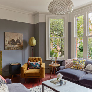 Photo of a victorian living room in London with medium hardwood flooring and multi-coloured walls.