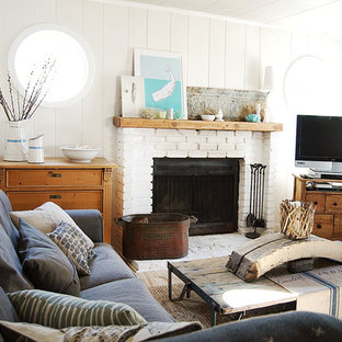 Example of a small coastal open concept living room design in Portland with gray walls, a standard fireplace and a brick fireplace