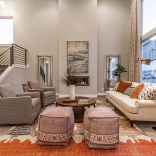 ソルトレイクシティの広いトランジショナルスタイルのおしゃれなLDK (グレーの壁、カーペット敷き、横長型暖炉、フォーマル、テレビなし、漆喰の暖炉まわり、茶色い床) の写真