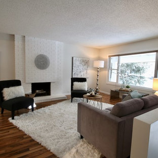 Inspiration for a transitional light wood floor living room remodel in Calgary with a brick fireplace