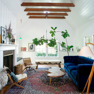 Living room - mid-sized cottage enclosed medium tone wood floor living room idea in Los Angeles with white walls and a standard fireplace