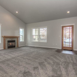 Living room - large traditional open concept and formal carpeted and gray floor living room idea in Portland with gray walls, a standard fireplace, a wood fireplace surround and no tv