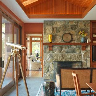 ボストンのおしゃれな独立型リビング (標準型暖炉、石材の暖炉まわり、フォーマル、オレンジの壁) の写真