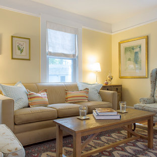 Inspiration for a medium sized coastal living room in Boston with yellow walls.